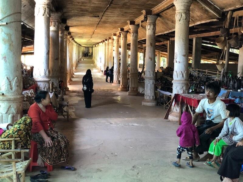 corridor to Shwe Indein Pagoda, inle lake myanmar, blue sky and wine