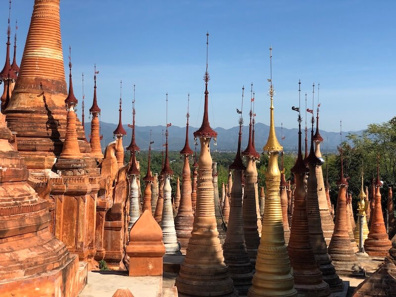 in dein stupas inle lake mixed, blue sky and wine