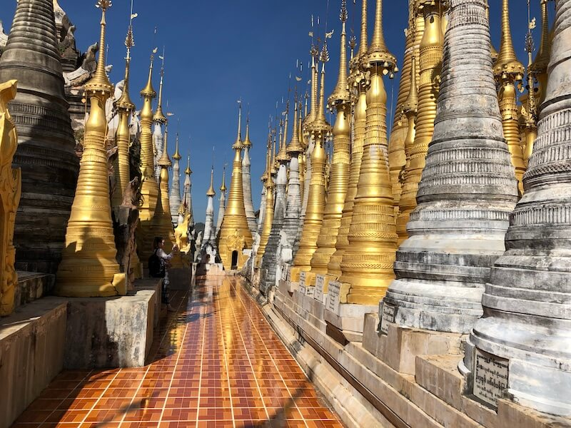 in dein stupas inle lake new, blue sky and wine