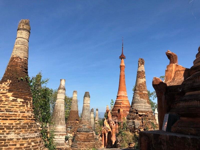 indein stupas inle lake in bricks, blue sky and wine