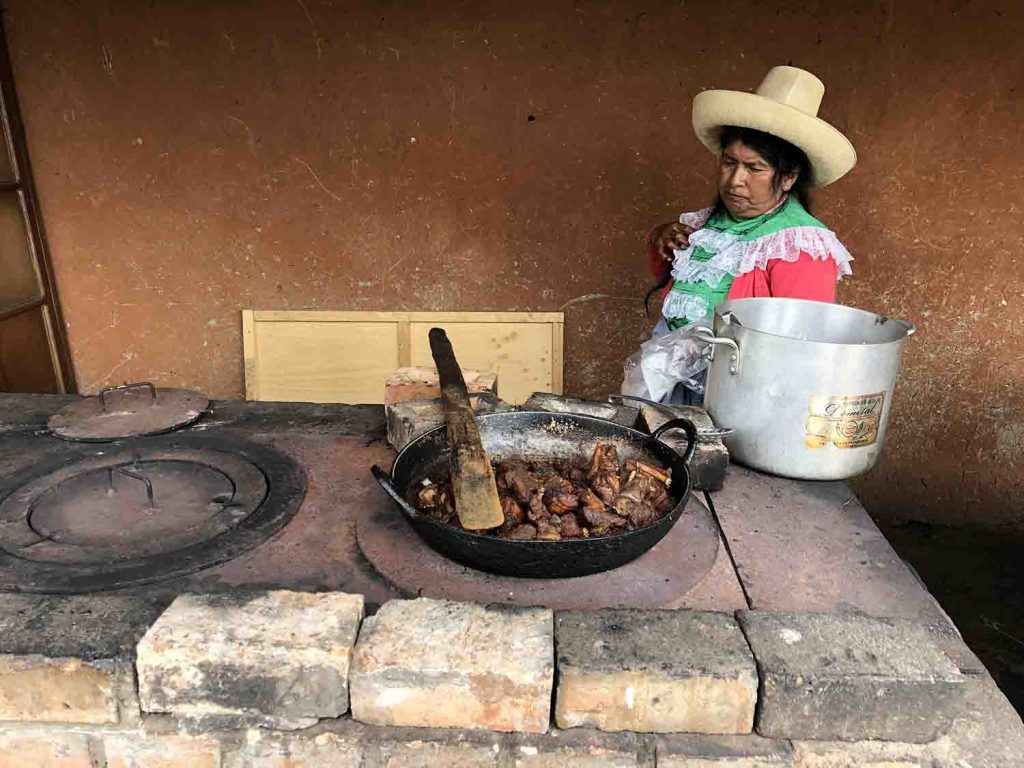 local pork vendor inside Cumbe Mayo park, Cajamarca Peru, Blue Sky and Wine Travel Blog