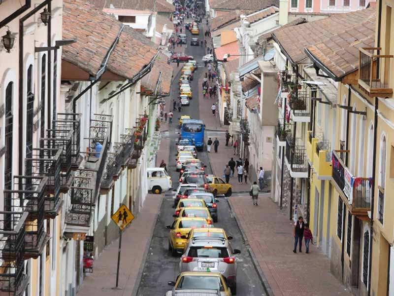 Busy traffic in the historical center, Quito, Blue Sky and Wine Travel Blog